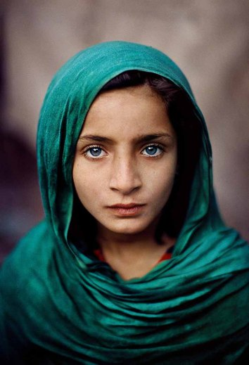 Afghan Refugee. Peshawar, Pakistan, 2002. CAPTION: Girl with Green Shawl. Peshawar, Pakistan, 2002. MAX PRINT SIZE: 40X60 PAKISTAN-10003 Girl in a green headscarf, Peshawar, Pakistan, 2002. Every photograph is an allegory. As soon as we have grasped the contents of an image our minds start to envisage a life before and after this decisive moment. Portraiture is especially responsive to the imaginary narratives we may weave around a picture. Each face is unique; we have never seen it before and we will never see it again. It is this newness of a portrait that compels us to construct stories. Yet, in doing so we often reach for the familiar. This young child had fled the civil war in Afghanistan and was living in Pakistan when McCurry took this picture. The delicate emerald shawl, her rich blue eyes and serene gaze all evoke a deep sense of the religious. - In the Shadow of the Mountains IG: This young ten-year old Afghan refugee girl living in Peshawar, Pakistan, had never seen her homeland of Afghanistan when I took this portrait. 02/15/2017 Peshawar, Pakistan, 2002 -Portraits Magnum Photos, NYC56585, MCS2002009K001 Phaidon, Iconic Images, final book_iconic, page 223. A ten-year old Afghan refugee girl living in Peshawar, Pakistan, has never seen her homeland. Girl with Green Shawl, Peshawar, Pakistan, 2002 (Looking East, 102) In the Shadow of Mountains_Book Looking East_Book Iconic_Book PORTRAITS_book Afghanistan_book PORTRAITS_APP final print_MACRO final print_Sao Paulo final print_Milan final print_Birmingham final print_HERMITAGE final print_Zurich Fine Art Print final print_Michener retouched_Sonny Fabbri 01/06/2017 MAX PRINT SIZE: 40X60